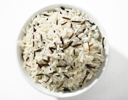 cooked rice: Black and white long-grain rice - top view of cooked black   white rice in white ceramic bowl