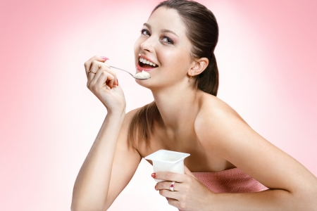 eating yogurt: Charming woman eating yogurt