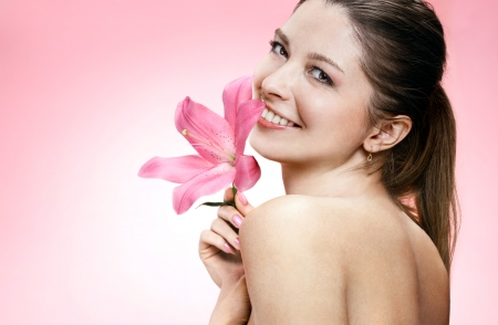 Alluring young woman with flower  photo