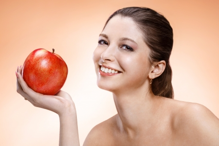 Attractive woman with apple  photo