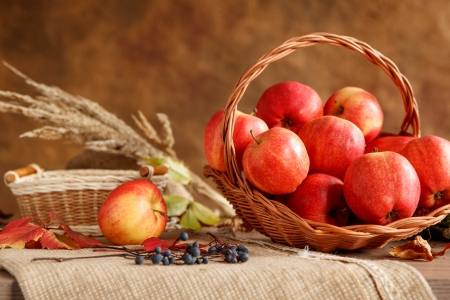 Season of the apple harvest - photo of ripe apples in basket Stock Photo