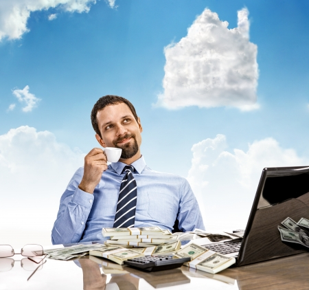 cash on hand: Daydreaming businessman with a cup of tea with head in the clouds - man hold cup of tea day dreaming looking up Stock Photo