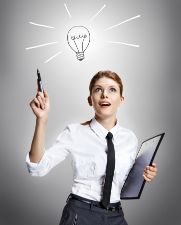 countenance: Cool idea - attractive woman wearing a white shirt with a tie and a folder in her hand like the idea - on grey background Stock Photo