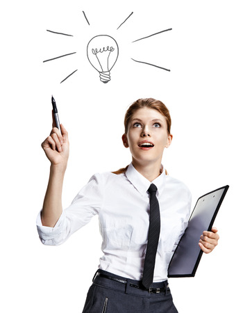 coming up with: Girl coming up with a light bulb idea sign - attractive woman wearing a white shirt with a tie and a folder in her hand like the idea - isolated on white background Stock Photo