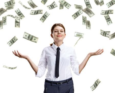 countenance: Dream of raining money - studio shoot of beautiful attractive business woman under money rain - isolated on white background Stock Photo