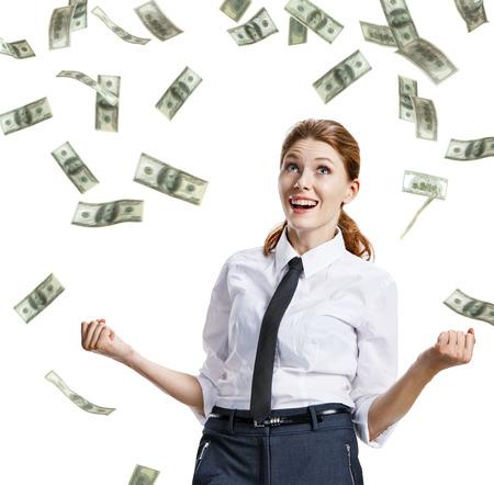 money falling: It is raining money - stock image of money falling on happy businesswoman - isolated on white background