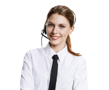 Customer support operator - portrait of young attractive brunette girl with headset - isolated on white background photo