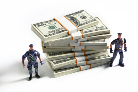 USD security - studio photography of toy collectors with united states money stacks photo
