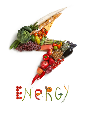detoxing: Energy diet - healthy food symbol represented by foods in the shape of flash to show the health concept of eating well with fruits and vegetables Stock Photo