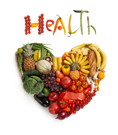 detoxing: Health food handbag - healthy food symbol represented by foods in the shape of a heart to show the health concept of eating well with fruits and vegetables Stock Photo