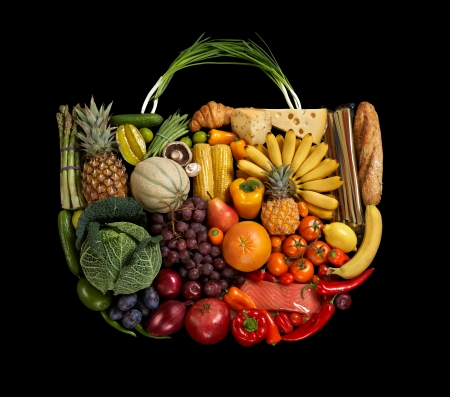 Assorted fruits handbag - studio photography of designer handbag made from different fruits and vegetables - on black background