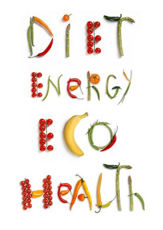 다이어트, 에너지, 에코, 건강 - 흰색 배경에 음식 단어의 스튜디오 사진 - 스톡 콘텐츠