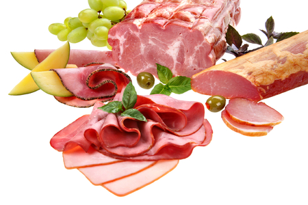 Beautiful sliced food arrangement - studio photography of meat products - isolated over white background Stock Photo - 24313362