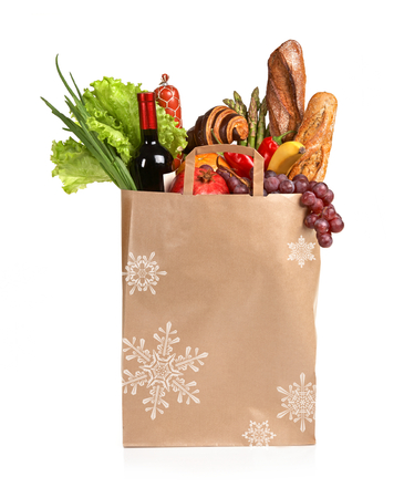 white paper bag: A paper bag full of groceries - studio photography of brown grocery bag with fruits, vegetables, bread, bottled beverages - isolated over white background Stock Photo