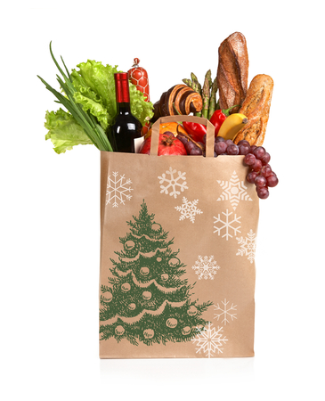 Christmas shopping bag - studio photography of brown grocery bag with fruits, vegetables, bread, bottled beverages - isolated over white background photo
