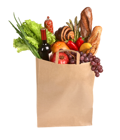 Full grocery bag - studio photography of brown grocery bag with fruits, vegetables, bread, bottled beverages - isolated over white background photo