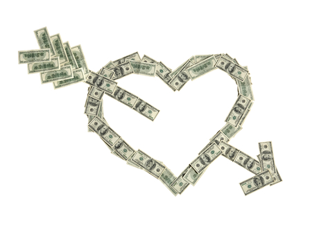 Heart shape of broken heart by an arrow - studio photography of american moneys of hundred dollar on white background photo