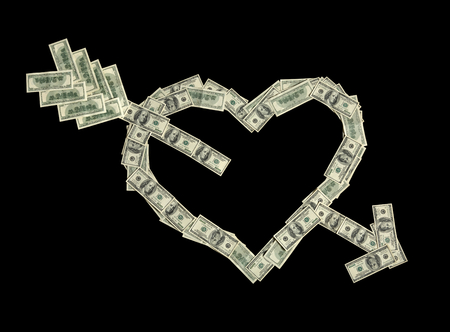 Broken heart with arrow - studio photography of american moneys of hundred dollar on black background photo