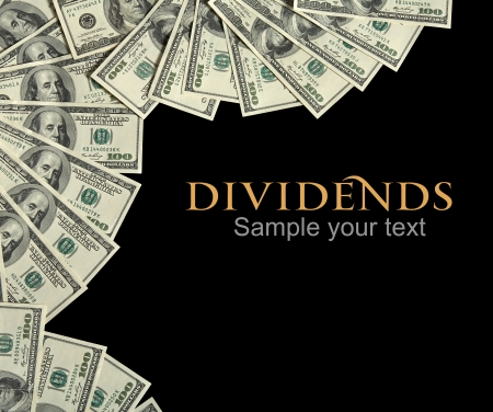 us currency: Dividends background concept and place for the text - studio photography of american currency of hundred dollar on black background Stock Photo