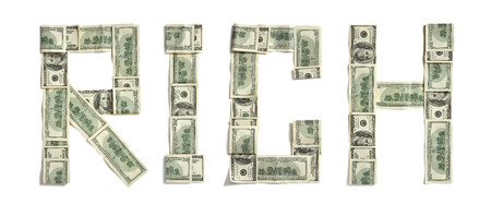 Word  RICH  made of dollars - studio photography of money made word - on white background Banco de Imagens