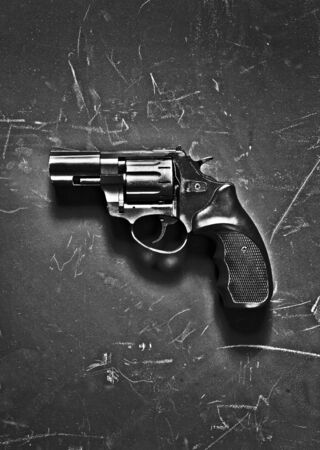 vindictive: handgun on black background Stock Photo