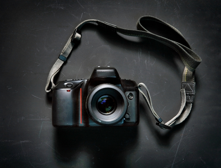 Professional camera on black background