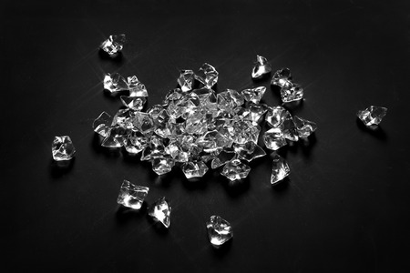scattered: scattered diamonds on black background Stock Photo