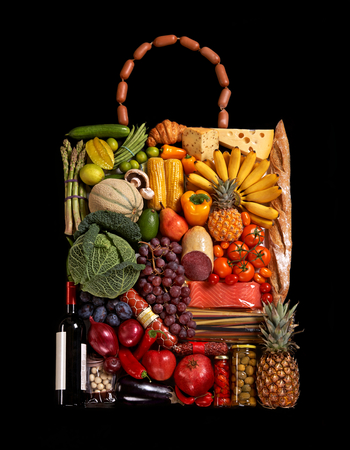 designer handbag made from different fruits and vegetables on black background photo
