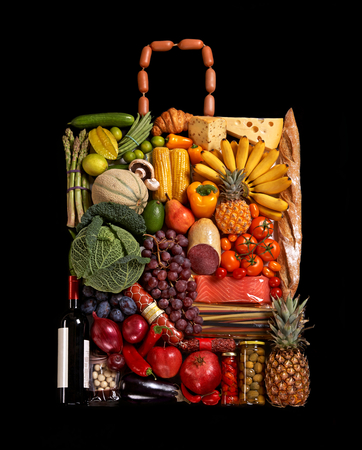 handbag made from different fruits and vegetables on black background photo
