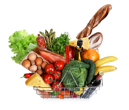 foodstuff: steel wire supermarket shopping carts basket with foodstuff on white background