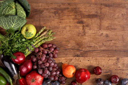 different fruits and vegetables on old wooden table photo