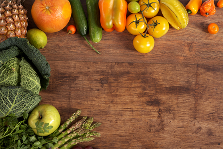 different fruits and vegetables on old wooden table