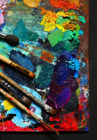 art supplies: Painting brushes and palette - studio photography of paint utensils on black  Stock Photo