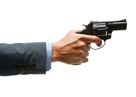 culpable: Male hand aiming revolver gun
