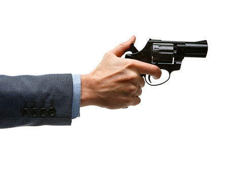 culpable: Male hand cocking revolver gun