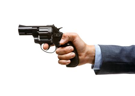 black grip: Revolver in hand - studio photography of man s hand holding handgun Stock Photo