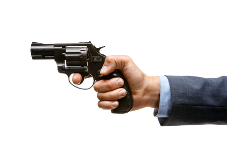 Revolver in hand - studio photography of man s hand holding handgun Stock Photo