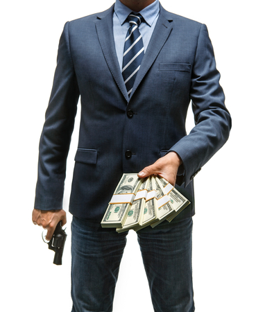 felonious: Gangster is taking money - studio photography of criminal man with money and gun - isolated on white background Stock Photo
