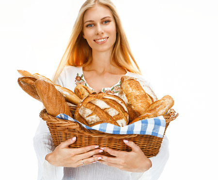Hilarious woman with bread and rolls photo