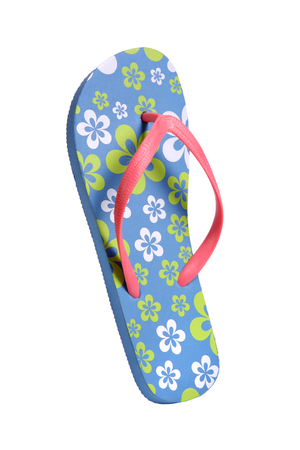 Flip flops with flowers - object photography in a studio of women s beach shoes - isolated on white background