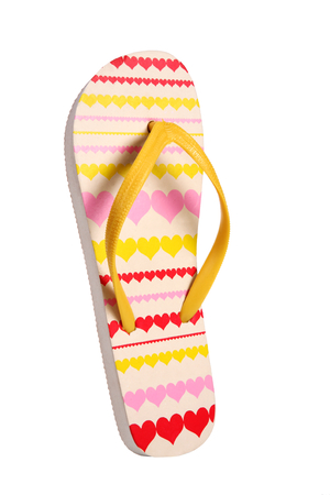 Brightly colored flip flops with hearts - object photography in a studio of women s beach shoes - isolated on white background