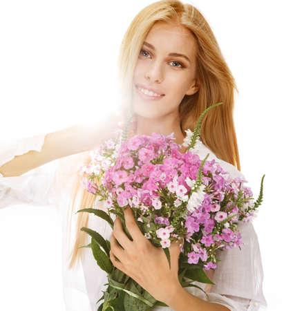 国際女性の日 3 月 8 日 - 白背景に手に花の花束を持った若い女性の肖像画 写真素材
