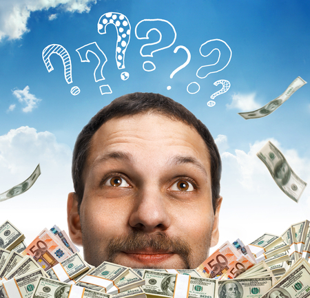 Have head in the clouds  Visualization - head of a happy man with a mustache, surrounded by money