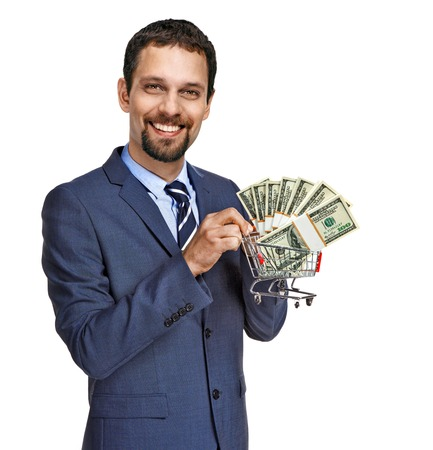 proposes: Are you ready for sales shopping  - successful businessman proposes stacks of dollar bills for shopping - isolated on white background