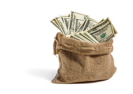 Geld in de zak - studiofotografie van zak met honderd dollarbiljetten