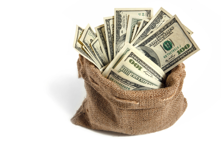 Bag with money - studio photography of bag with hundred dollar bills