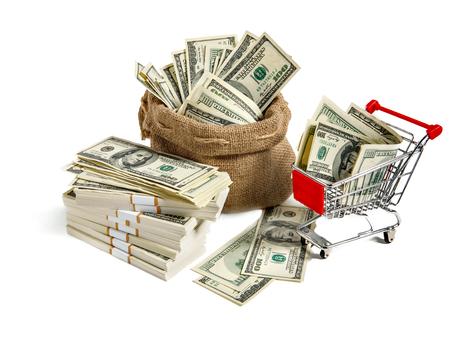 Sackful money - studio photography of bag and shopping cart full of dollar bills