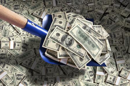 heap of dollar: Shovel up money - studio photography of American moneys of hundred dollar