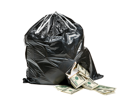 us currency: Garbage is money - studio photography of black plastic bag with hundred dollar bills on a white background