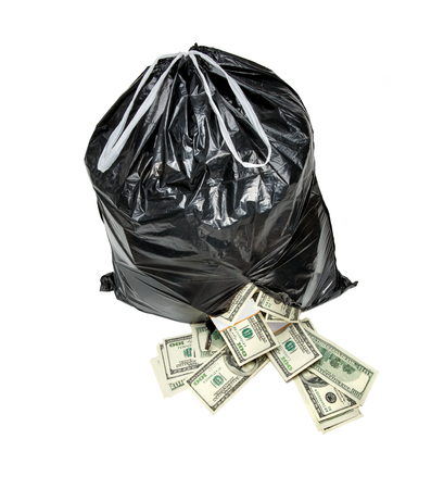 Rubbish is money - studio photography of black plastic bag with hundred dollar bills on a white background photo